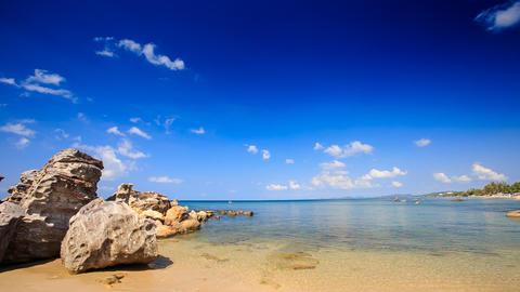 Transparent Waves Wash Rocks on Sand Beach of Azure Sea Footage