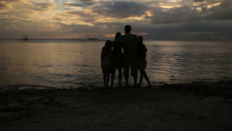 silhouette of family on the beach at sunset Footage