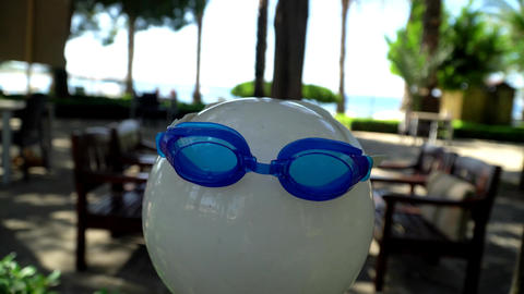 Lamp lighting with swimming goggles on sea background Filmmaterial