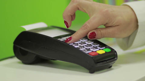 Hand using bank terminal for credit card payment Image