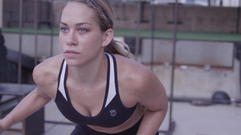 Tracking shot of a woman doing side stepping running drills Footage