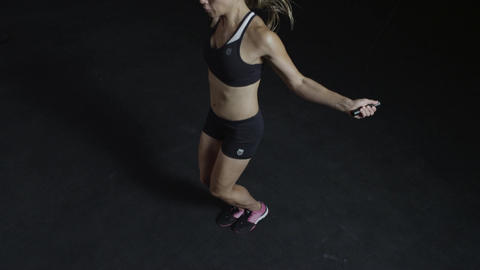 A woman Jumping rope in slow motion, jump rope exercise in a fitness gym Footage