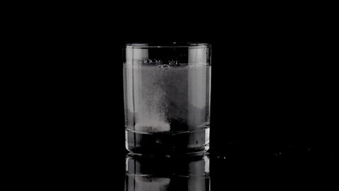Effervescent tablet falling in a glass of water Footage