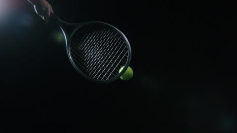 Isolated Tennis ball hit with racquet in slow motion Footage