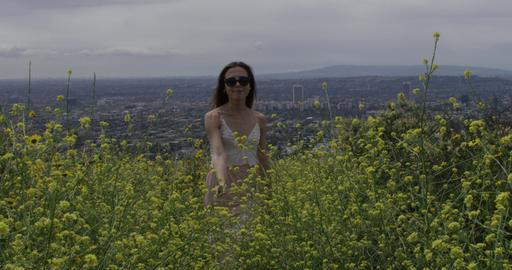 Woman Runs Uphill Through Flowers Footage
