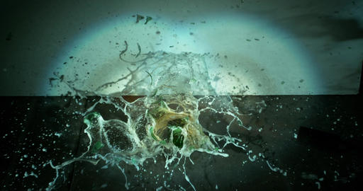 Green Beer Bottle Explodes Closeup Footage