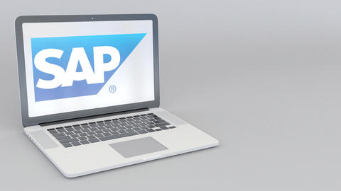 Rotating opening and closing laptop with SAP SE logo. Computer technology Footage