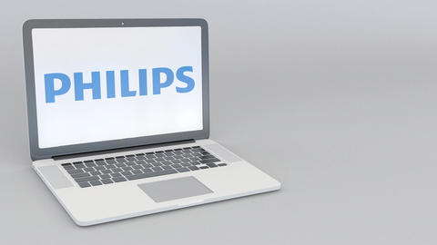 Rotating opening and closing laptop with Philips logo. Computer technology Footage