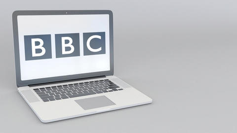 Rotating opening and closing laptop with British Broadcasting Corporation BBC Footage