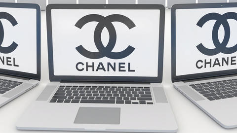 Laptops with Chanel logo on the screen. Computer technology conceptual editorial Footage
