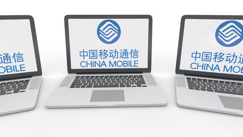 Notebooks with China Mobile logo on the screen. Computer technology conceptual Footage