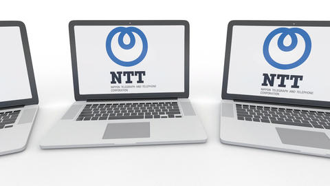Notebooks with Nippon Telegraph and Telephone Corporation NTT logo on the screen Footage