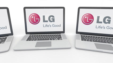 Notebooks with LG Corporation logo on the screen. Computer technology conceptual Live Action