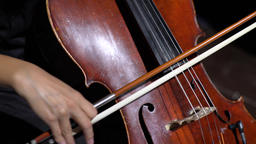 A female hand plays with a bow on a cello (close-up) Footage