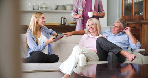 Parents With Adult Offspring Using Digital Devices At Home Live Action