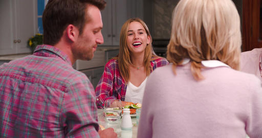 Family With Adult Offspring Enjoying Meal At Home Together Footage
