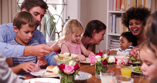 Group Of Families Having Meal At Home Together Footage