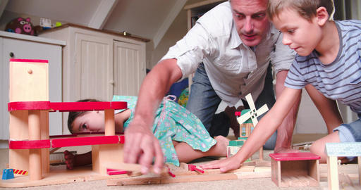 Father And Children Playing With Toys In Bedroom Footage