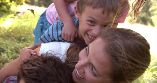 Young couple and kids having fun together outdoors Footage