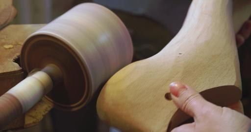 Bespoke Shoemaker Smoothing Wooden Last For Shoe On Sander Footage