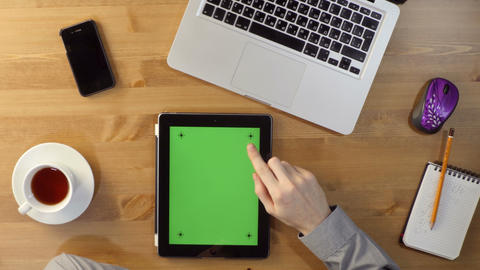 Using Laptop and Tablet PC with a green screen at the Desktop Live Action