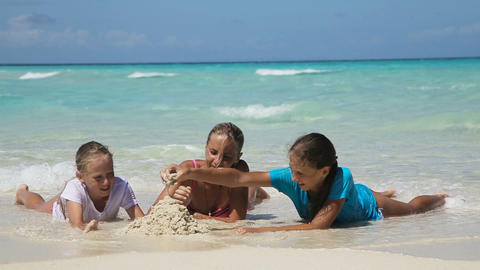 Happy family playing on the beach at the day time Footage