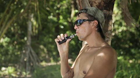 man smoking electronic cigarette Footage