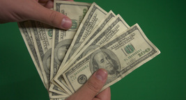 The currency of the United States. Hundred dollar banknotes on a green backgroun Footage