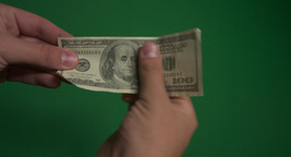 Hundred dollar banknote in hand Footage