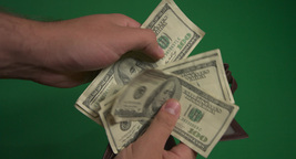 Open the wallet and pulls out a hundred dollar bill (green background, chromakey Footage