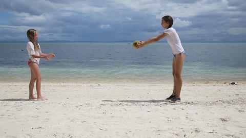 Children play with a ball on the beach outdoors Footage