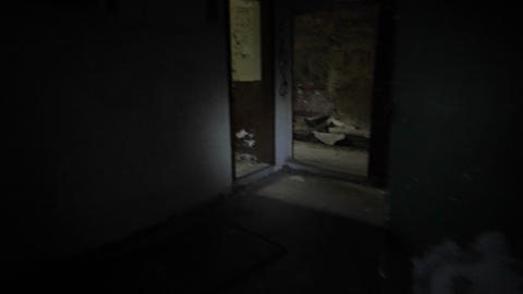 Exploring an abandoned building with torch light Footage