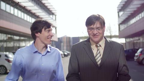 Business men walking and talking friendly Footage