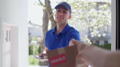 Delivery guy customer POV rack focus Footage