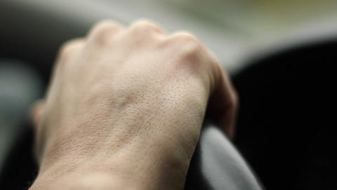 Hand Holding The Wheel And Driving stock footage