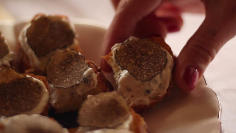 Hand taking a canape with truffles Footage