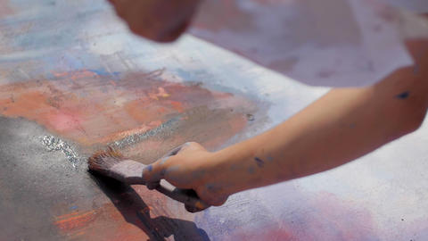 Slow motion of writer hand painting on the wall with brush Footage