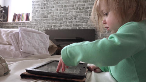 Toddler playing with tablet computer closeup touching screen ビデオ