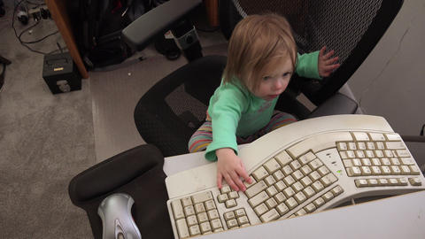Toddler working on computer typing on keyboard mousing day job Footage