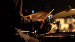 A drummer man playing drums (close-up) Footage