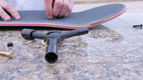 Guy makes holes in the skateboard Footage
