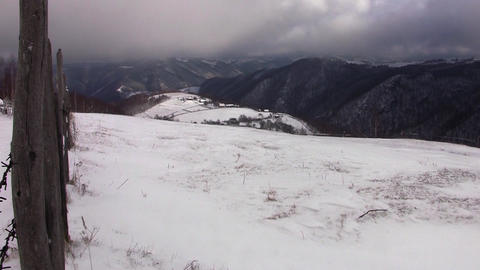 View over the mountains covered with snow during a cold winters 50 Footage