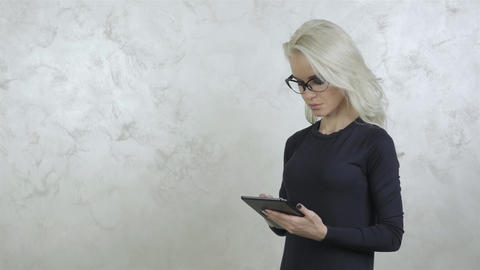 Beautiful Young Woman Model With Glasses and Tablet PC Footage