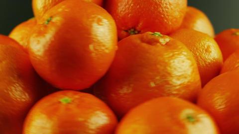 Macro Shot of Rotating Tangerines - Black Background Footage