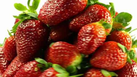 Rotating Strawberries on White Background Footage