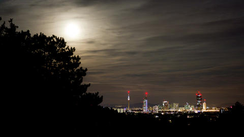 Night time-lapse moonrise skyline Image