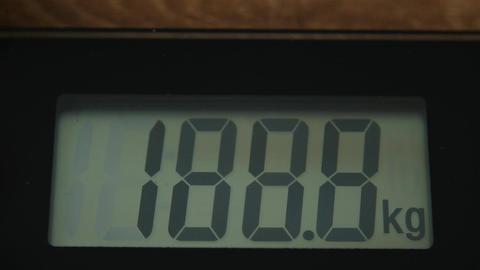 Bathroom digital scale close up with digits running up Live Action