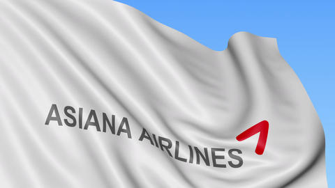 Waving flag of Asiana Airlines against blue sky background, seamless loop Footage