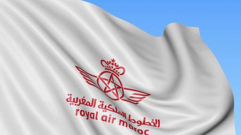 Waving flag of Royal Air Maroc against blue sky background, seamless loop Footage