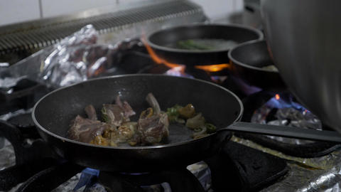 Young chef cooking lamb meat and exotic vegetables in luxury restaurant on the Footage